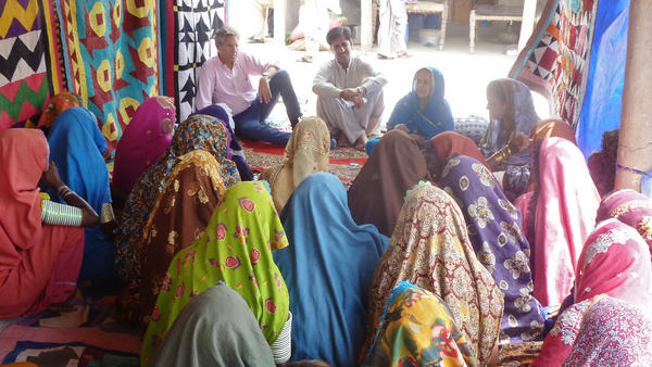Nick van Praag of Ground Truth meets with locals of Pakistan's Sindh Province in 2013 to see if they're satisfied with efforts to help them recover from previous floods and prevent damage from any future ones.