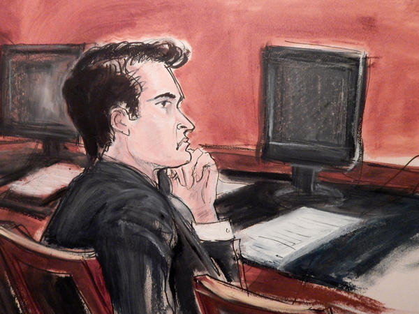 In this courtroom drawing, defendant Ross Ulbricht listens to proceedings from the defense table during opening arguments in his criminal trial in New York on Jan. 13. A jury convicted Ulbricht, the man linked to the underground marketplace Silk Road, of seven drug and conspiracy counts on Wednesday.