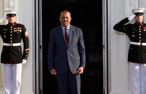 Libyan Prime Minister Abdullah al-Thinni arrives for a dinner hosted by President Obama last August in Washington. Thinni heads Libya's internationally recognized government, but due to the fighting among rival factions, he is operating from the eastern city of Bayda, hundreds of miles east of the capital, Tripoli.