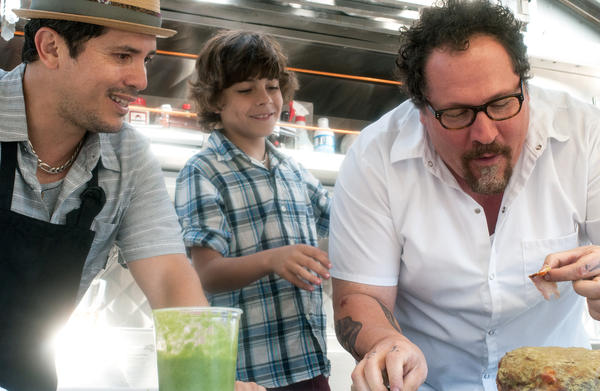 In <em>Chef</em>, Jon Favreau (right) plays a chef who leaves his post at a respected LA restaurant to launch a food truck with his son (Emjay Anthony, center) and a former line cook (John Leguizamo).