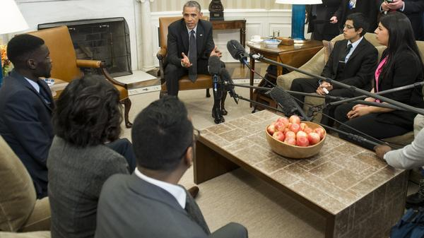 A federal judge has issued a temporary injunction to President Obama's executive orders on immigration. Earlier this month, Obama met with young immigrants, known as DREAMers, in the Oval Office.