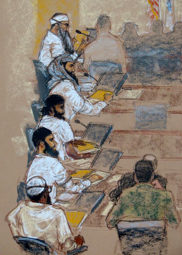 In this photo of a sketch by court artist Janet Hamlin, (top to bottom) Khalid Sheikh Mohammed, Walid bin Attash, Ramzi bin al-Shibh, Ammar al-Baluchi and Mustafa al-Hawsawi attend a hearing at the U.S. Naval Base in Guantanamo Bay, Cuba, in Jan. 2009.