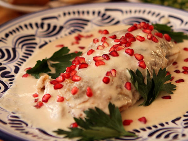 Detroit's top Mexican chefs are preparing dishes like these stuffed peppers, called <em>chiles en nogadas</em>, on their special menus in honor of Frida Kahlo.