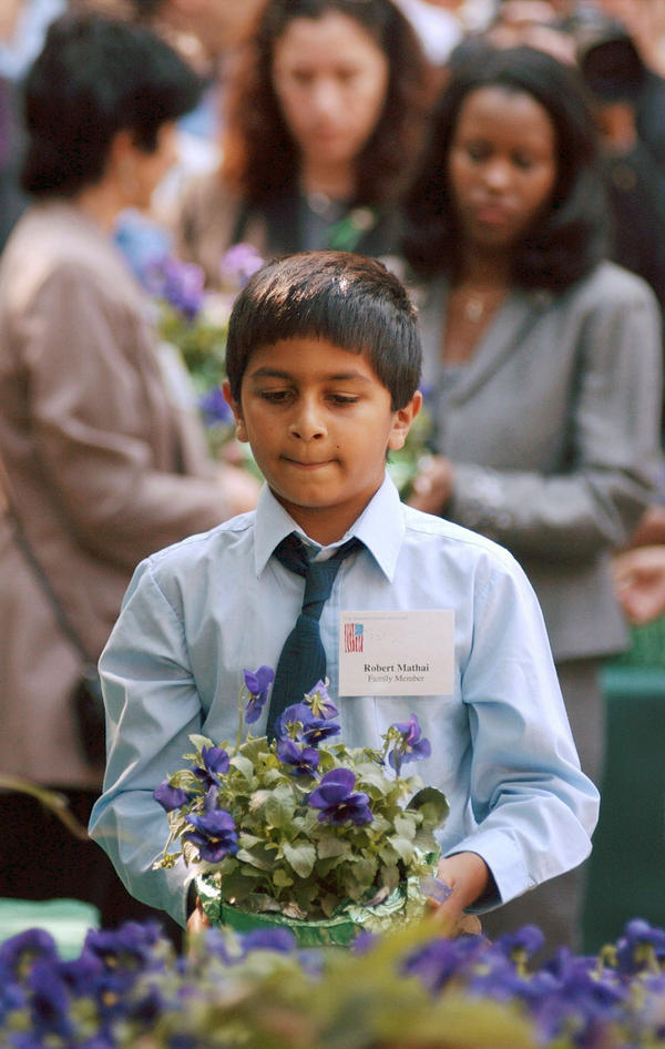 Robert Mathai was 8 when he lost his father, Joseph Mathai, a passenger on American Airlines Flight 11 when it crashed into the World Trade Center. In 2003, Robert, then 10, carried a pot of flowers to the site of a planned memorial in Boston. Mathai, who is a student at Tufts University, recently traveled to Guantanamo Bay to witness court proceedings against the alleged Sept. 11 masterminds.