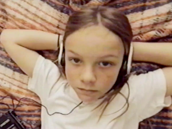 "A sullen pre-teen listens to music on his headphones in a scene from the Broncho video for the song ""NC-17."""