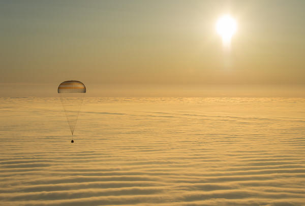The Soyuz TMA-14M spacecraft is seen as it descends toward Earth, carrying NASA's Barry Wilmore and Russian flight engineers Alexander Samokutyaev and Elena Serova.