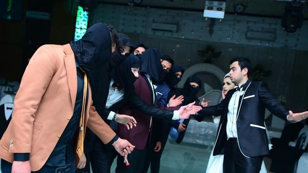 """A photo from the wedding of Ahmed Shehata and Shaimaa Daif shows friends of the couple mocking members of the so-called Islamic State. Shehata says he staged the surprise to show his wife that ISIS was """"something to laugh at, not to fear."""""""