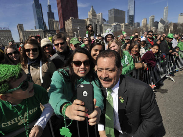 """Samantha Hernandez, 17, poses for a selfie with Chicago mayoral candidate Jesus """"Chuy"""" Garcia during the St. Patrick's Day parade in Chicago."""