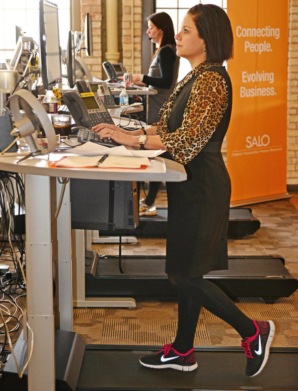 Maura Howard tries to log about 3 miles a day on a treadmill desk at Salo, a financial staffing company in Minneapolis. She says regular walking helps her avoid after-lunch drowsiness.