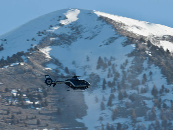 A police helicopter flies over part of Seyne-les-Alpes on Thursday, near the site where the Germanwings plane crashed Tuesday.
