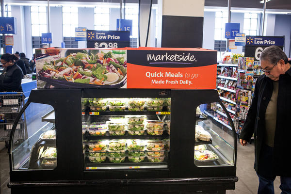 A customer peruses the ready-to-eat meal options at a Wal-Mart in Washington, D.C. In our grab-and-go times, freshly prepared meals are a big part of Wal-Mart's urban strategy.