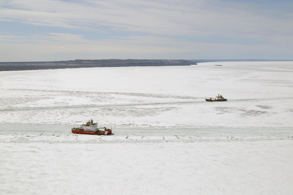 United States Coast Guard ships break up ice in eastern Lake Superior on Tuesday.