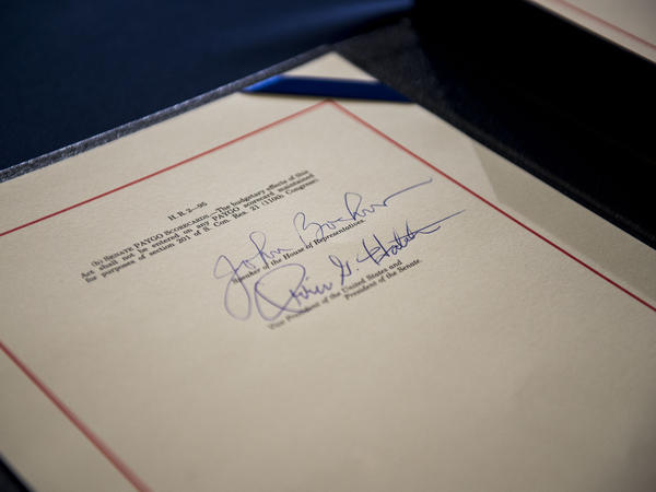 The signatures of House Speaker John Boehner and Sen. Orrin Hatch on the Medicare Access CHIP Reauthorization Act 2015.