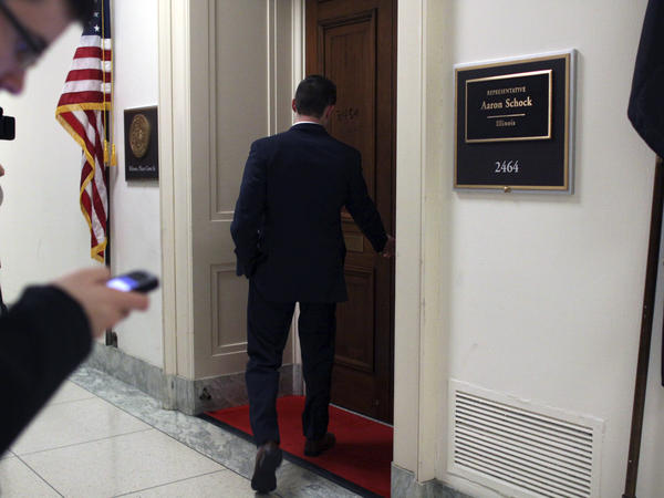 Media members gather outside the office of Rep. Aaron Schock after he announced his resignation from Congress on March 17.