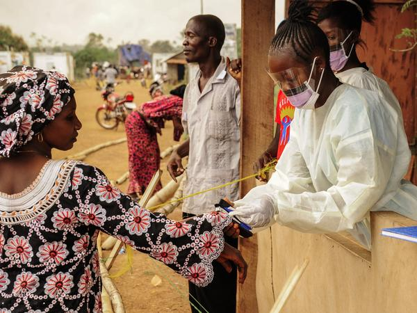 Sierra Leone health officials check people passing through the border with Liberia in Jendema last month. For the past two weeks, Sierra Leone has recorded only nine cases.