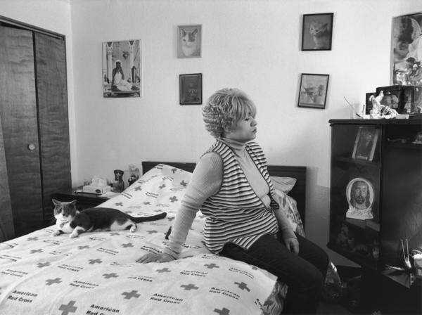 <em>Mom and Her Cat Ziggy on American Red Cross</em>, 2005, from <em>The Notion of Family</em> (Aperture, 2014).