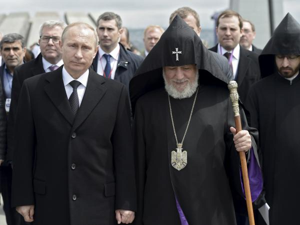 Catholicos Karekin II (R, front), the supreme head of the Armenian Apostolic Church, and Russia's President Vladimir Putin walk to attend a commemoration ceremony marking the centenary of the mass killing of Armenians by Ottoman Turks in Yerevan, Armenia.