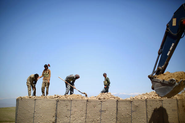 Workers set up a local police checkpoint in Nangahar Province, just a few miles from the Pakistan border. Many insurgent fighters slip over the mountains from Pakistan. That's why this checkpoint is being set up.