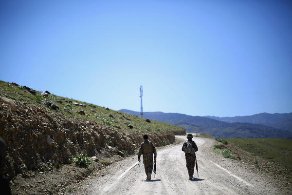 Afghan army soldiers head up a road in Nangahar Province, where Taliban fighters are attacking a police checkpoint that is under construction. The Afghan military is much more active in the fight compared to a couple of years ago, when troops hung back on patrols and let the Americans lead.