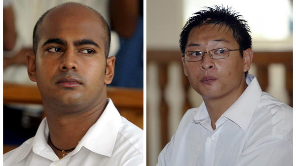 A composite image of file photos shows Australians Myuran Sukumaran (left) and Andrew Chan in Denpasar district court in Bali. Indonesia executed the two men, along with six others, early Wednesday.