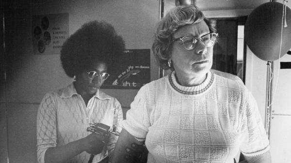 Health worker Jackie Carnegie delivers a rubella vaccine in Colorado in 1972.