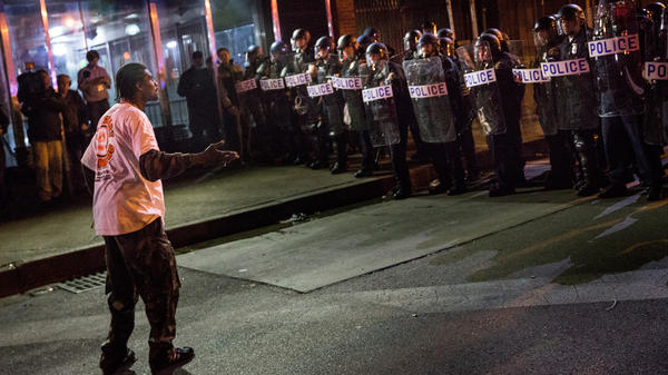 People protesting the death of Freddie Gray and demanding police accountability took to the streets in Baltimore's Sandtown neighborhood again Thursday night.