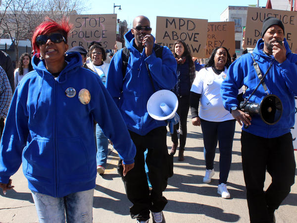 Maria Hamilton (left) marches in Milwaukee with her sons on April 30 in remembrance of her son Dontre, who was shot and killed by a now-former police officer in a park last year. Hamilton founded Mothers for Justice United, which planned a march on Washington on Saturday to protest police violence.