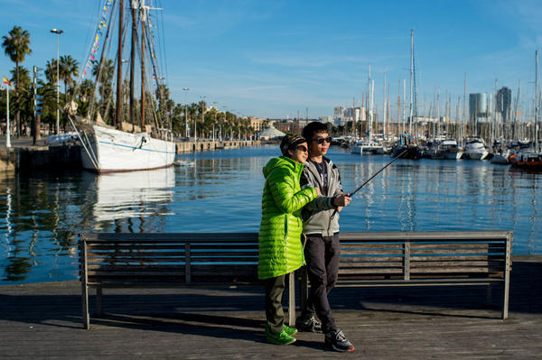Tourists take a photo with a selfie stick at the Old Harbour of Barcelona on December 25, 2014 in Barcelona, Spain. (David Ramos/Getty Images)