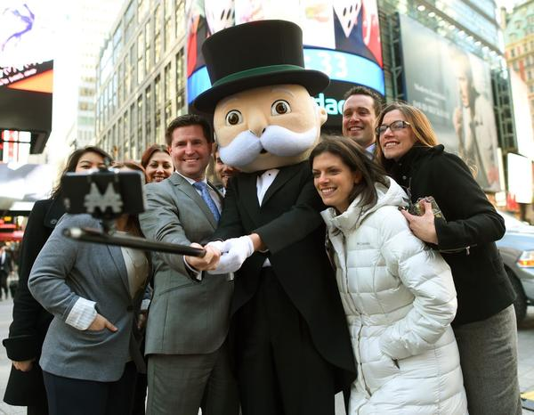 Mr. Monopoly uses a selfie stick to take a photo in Times Square on March 19, 2015. (Timothy A. Clary/AFP/Getty Images)