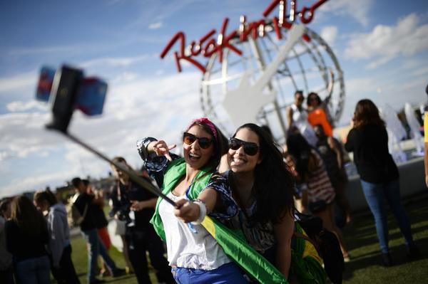 Festival goers user a selfie stick to take a snapshot of themselves at the Rock in Rio USA music festival at the MGM Resorts Festival Grounds in Las Vegas, Nevada on May 15, 2015.  (Robyn Beck/AFP/Getty Images)