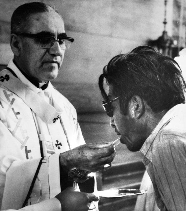 Archbishop Oscar Arnulfo-Romero offers the host wafer during the communion rite to a member of the congregation during a church mass in San Salvador, El Salvador on Jan. 13, 1980.