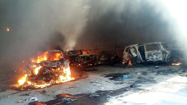 Authorities say these vehicles caught fire during a gunbattle in a warehouse at Rancho del Sol, near Ecuanduero, in western Mexico, on Friday.
