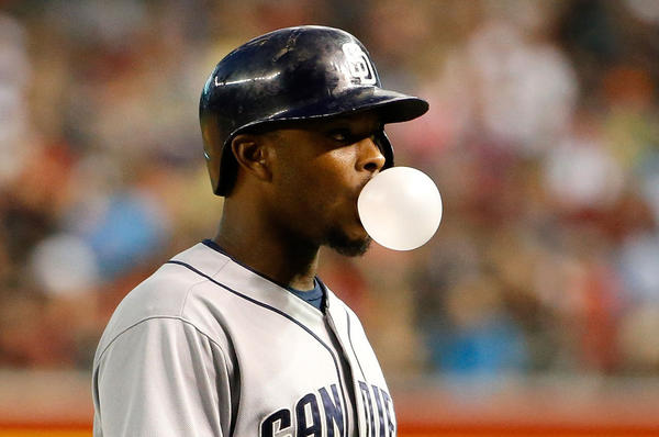 Justin Upton #10 of the San Diego Padres blows a bubble as he walks off the field after batting against the Arizona Diamondbacks during the eighth inning of the MLB game at Chase Field on May 9, 2015 in Phoenix, Arizona. (Christian Petersen/Getty Images)
