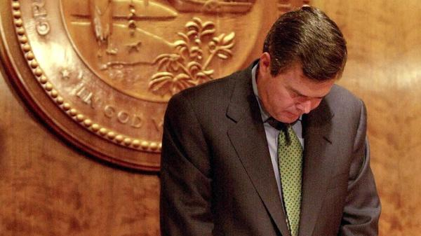 """Jeb Bush, seen here bowing his head in prayer as governor of Florida in 2000, is deeply religious. """"Twenty years ago I converted to Catholicism,"""" Bush said last month. """"It was one of the smartest things I've done in my whole life."""""""