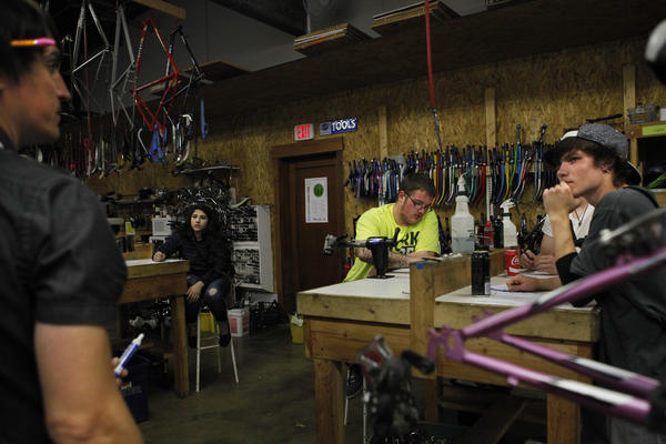 Daryl Miller's physics class meets off-campus at the Des Moines Bike Collective, a nonprofit bicycle repair shop.
