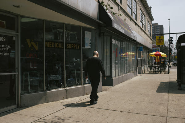 Brian Nelson walks outside his office at the Uptown People's Law Center in Chicago. He says adjusting to life outside of prison is a daily struggle, but his work as a prisoner's advocate helps.