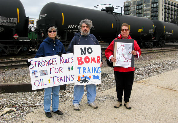 Stephanie Bilenko of La Grange, Ill., (from left) Paul Berland of suburban Elgin and Dr. Lora Chamberlain of Chicago are members of a group urging more stringent rules for the oil-carrying trains.