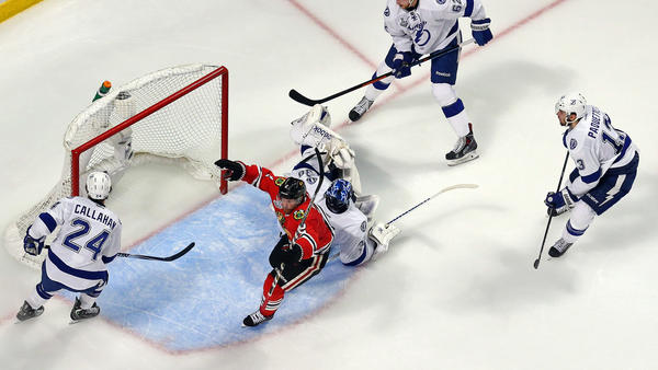 Duncan Keith of the Chicago Blackhawks scores a goal Monday in the second period against goalie Ben Bishop of the Tampa Bay Lightning during Game 6 of the 2015 NHL Stanley Cup Final in Chicago.
