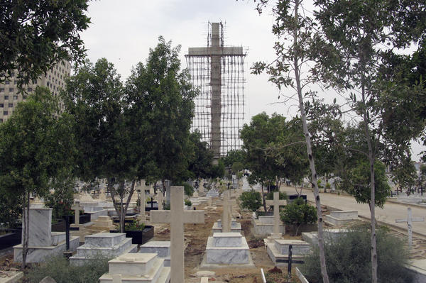 The cross is being built at the entrance to the main Christian cemetery in Karachi.