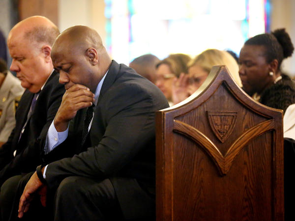 U.S. Sen. Tim Scott bows his head in prayer during a prayer vigil held at Morris Brown AME Church on Thursday, June 18, 2015 in Charleston, S.C. The service honored victims of Wednesday's shooting at Emanuel AME Church.