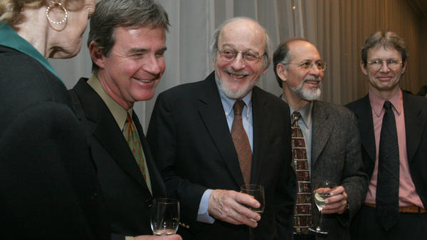 """E.L. Doctorow, center, stands with other National Book Critics Circle award winners in March 2006 at a reception following the awards ceremony in New York. Doctorow's """"The March"""" won the prize for fiction that year."""