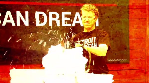 In a campaign video, Rand Paul uses a chainsaw to shred 1,700 pages of what he says represents the federal tax code. Paul is offering a flat-tax plan that fits on one page.