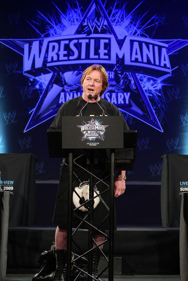 """Rowdy"" Roddy Piper, clad in his trademark kilt, speaks in 2009 at the WrestleMania 25th anniversary press conference at Hard Rock Cafe in New York City. Piper fought in the main bout at the first WrestleMania in 1985, losing a tag-team match to Hulk Hogan and Mr. T."