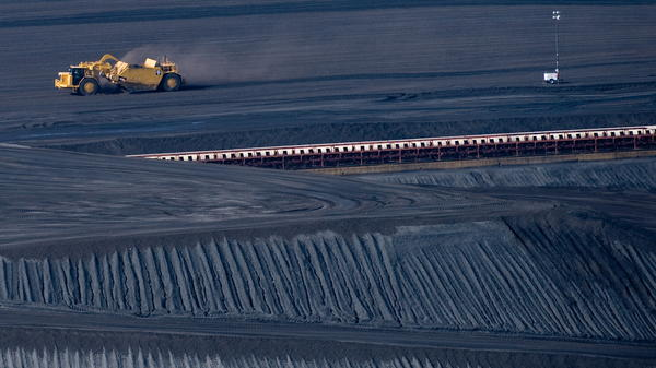 A coal scraper machine works on a pile of coal at American Electric Power's Mountaineer coal power plant in 2009 in New Haven, W.Va. The state, in which coal mining is a major industry, is one party planning to sue the Environmental Protection Agency regarding new power plant regulations announced Monday.