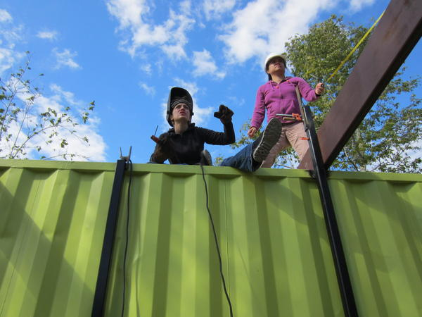 Tulane students Ellanny Page (left) and Vicky Leung helped build the Grow Dat Youth Farm.