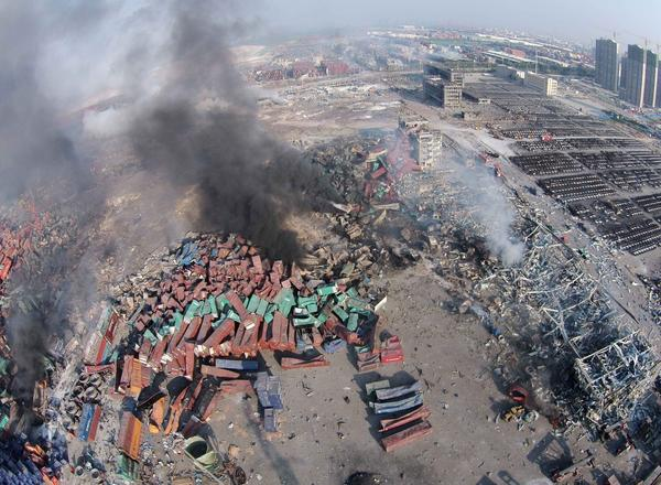 An aerial view shows the explosion site in Tianjin, north China. Dozens of people died in twin blasts Thursday.