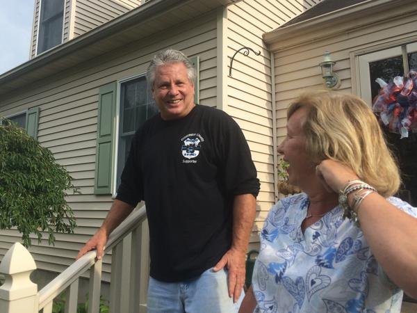 """Michael and Maureen McCabe's neighborhood is full of zombie houses, including the one next door. """"We don't know what's going to happen,"""" Michael McCabe says."""
