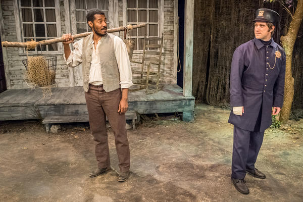 Stephen Van Cleef, a fictional Seneca Village resident played by Billy Eugene Jones (left), meets a New York City police officer, played by Andy Truschinski, in <em>The People Before the Park</em> at Premiere Stages at Kean University in Union, N.J.