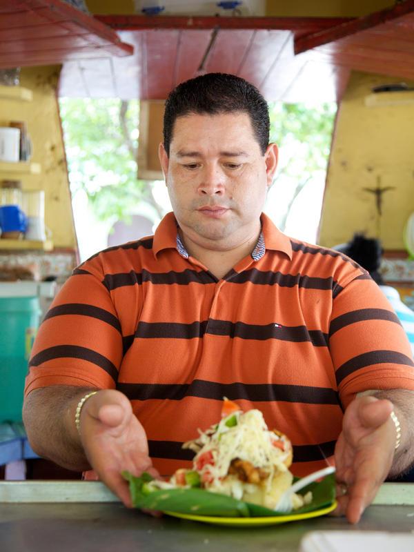 Francisco Javier Gomez Torres serves up to 300 plates of vigorón a day at his kiosk El Gordito in Granada, Nicaragua.
