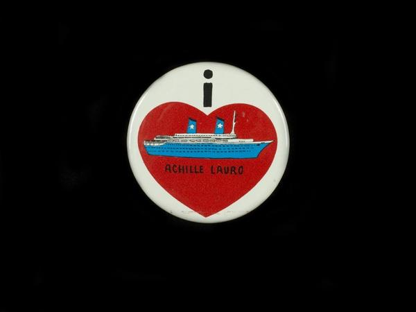 A promotional button from the hijacked ship.